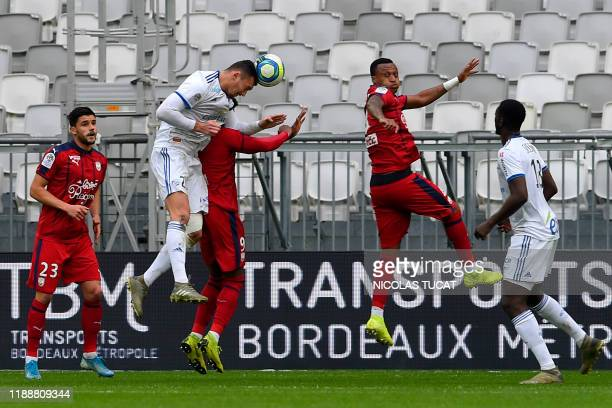 Strasbourg's French forward Ludovic Ajorque heads the ball to scores a goal during the French Ligue 1 football match between Bordeaux and Strasbourg...