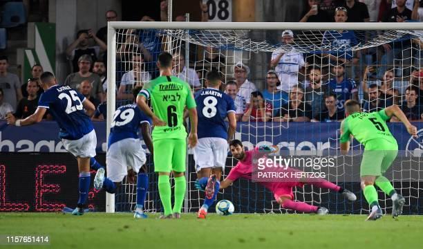 Strasbourg's French forward Ludovic Ajorque scores a penalty kick against Maccabi Haifa's Israeli goalkeeper Guy Haimov during the UEFA Europa League...