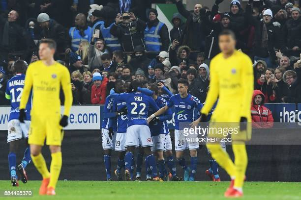 Strasbourg's French forward Stephane Bahoken celebrates with teammates after scoring a goal during the French L1 football match between Strasbourg...