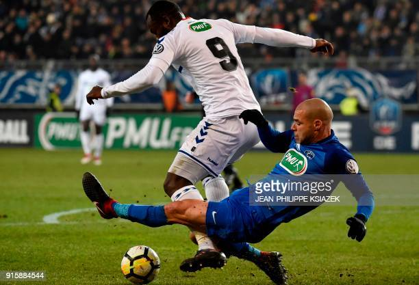 Strasbourg's French forward Stephane Bahoken vies with Grenoble's French defender Selim Bengriba during the French Cup football match between...