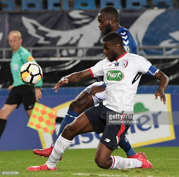 Strasbourg's French forward Stephane Bahoken vies with Lille's Cameroon midfielder Ibrahim Amadou during the French Cup football match between...
