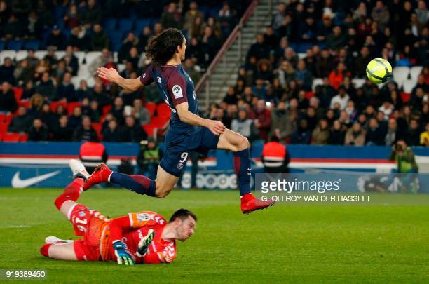 Strasbourg's French goalkeeper Alexandre Oukidja looks on as Paris SaintGermain's Uruguayan striker Edinson Cavani scores a goal during the French...