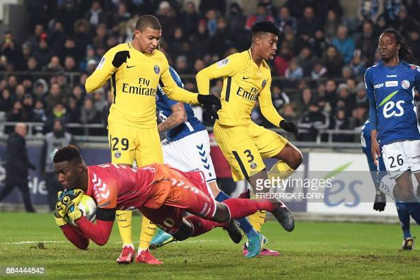 Strasbourg's French goalkeeper Bingourou Kamara catches the ball in front of Paris SaintGermain's French forward Kylian Mbappe and Paris...