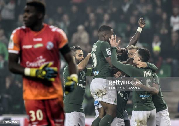 Strasbourg's French goalkeeper Bingourou Kamara looks on as SaintEtienne's French forward Kevin MonnetPaquet is congratulated by teammates after...
