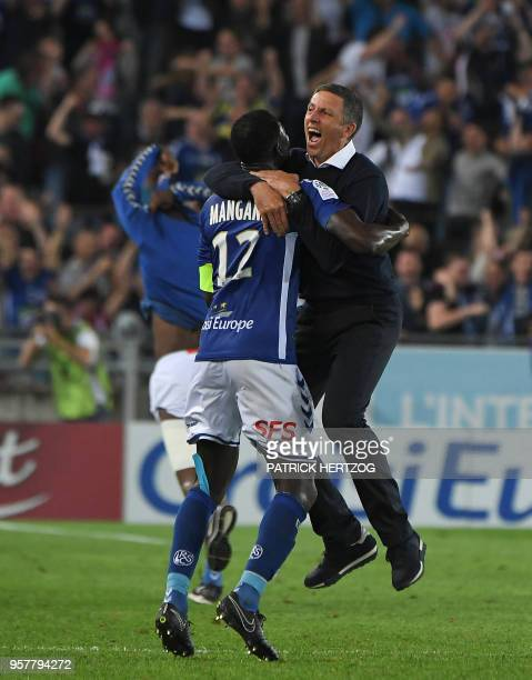 Strasbourg's French head coach Thierry Laurey celebrates with his captain Strasbourg's Senegalese defender Kader Mangane after the third goal during...