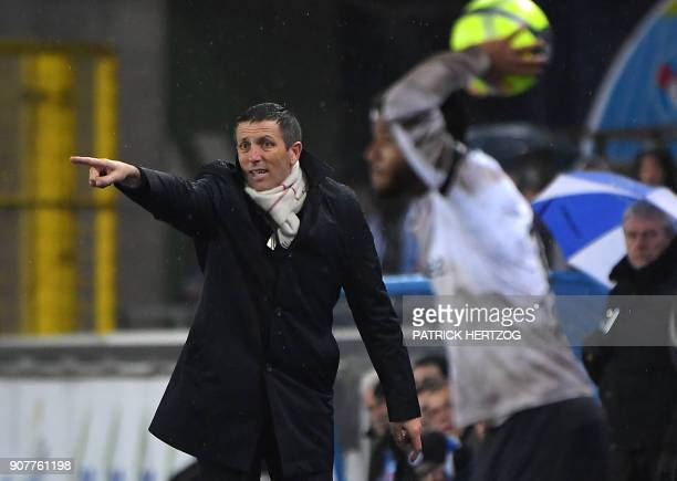 Strasbourg's French head coach Thierry Laurey gestures during the French Ligue 1 football match between Strasbourg and Dijon on January 20 2018 at...