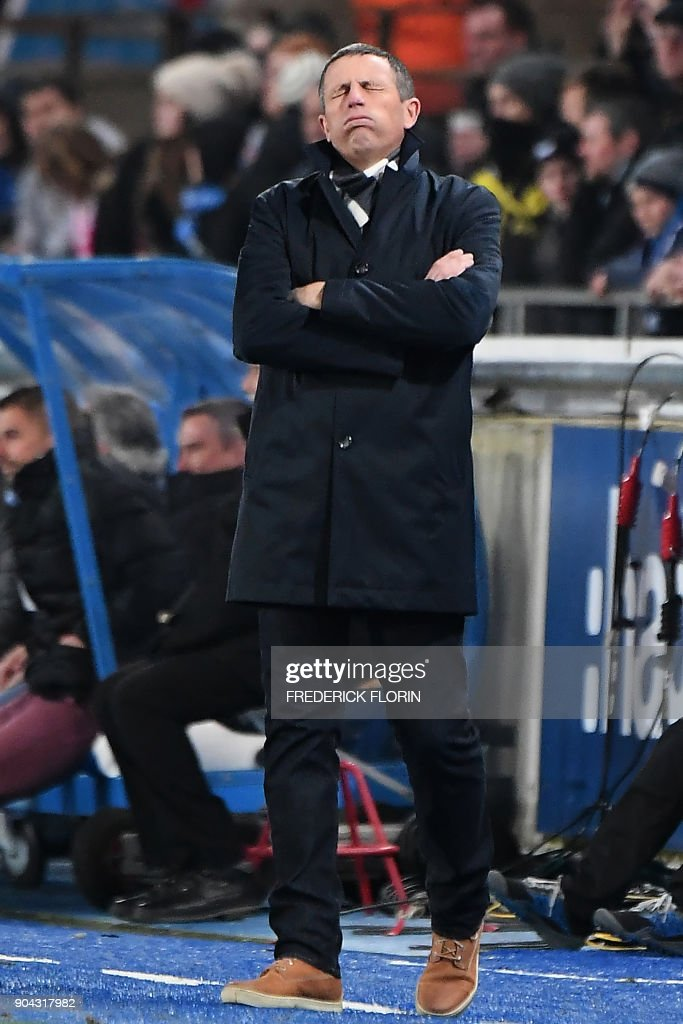 Strasbourg's French head coach Thierry Laurey reacts during the French L1 football match between Strasbourg (RCSA) and Guingamp (EAG) on January 12, 2018 at the Meinau stadium in Strasbourg, eastern France. /
