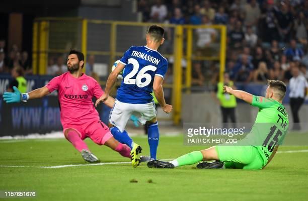 Strasbourg's French midfielder Adrien Thomasson scores a goal past Maccabi Haifa's Israeli goalkeeper Guy Haimov and Maccabi Haifa's Israeli defender...