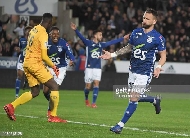 Strasbourg's French midfielder Anthony Goncalves reacts after scoring his second goal during the French L1 football match between Strasbourg and...