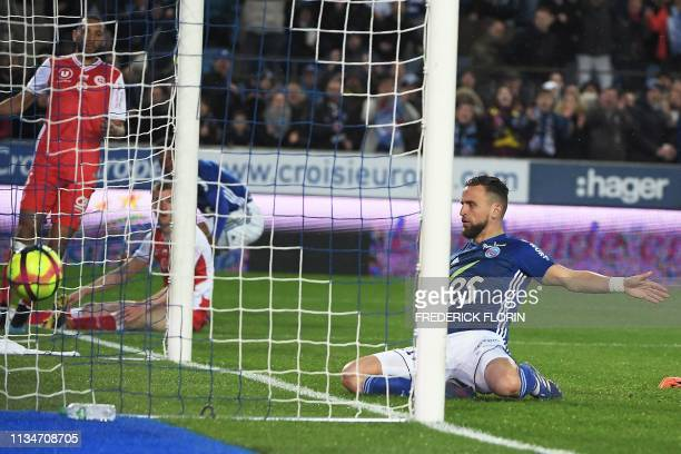 Strasbourg's French midfielder Anthony Goncalves scores a goal during the French L1 football match between Strasbourg and Reims on April 3 at the...