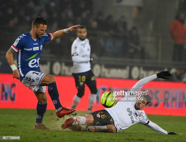 Strasbourg's French midfielder Anthony Goncalves vies with Dijon's Portuguese midfielder Xeka during the French Ligue 1 football match between...
