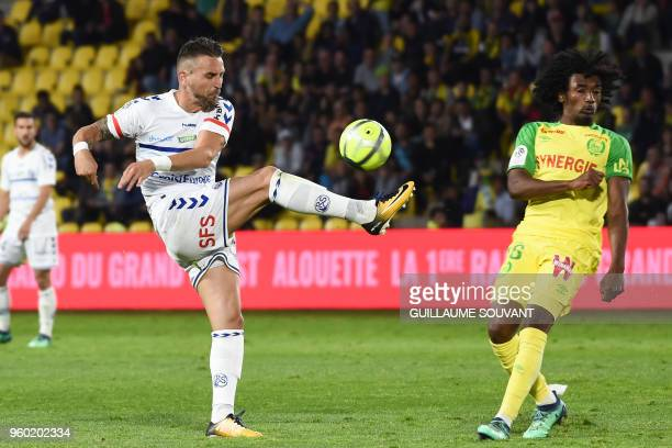 Strasbourg's French midfielder Anthony Goncalves vies with Nantes' French midfielder Samuel Moutoussamy during the French L1 football match between...