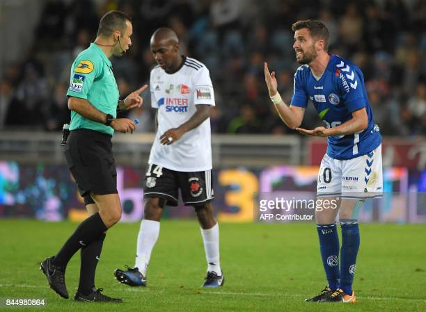 Strasbourg's French midfielder Benjamin Corgnet argues with French referee Jerome Brisard during the French L1 football match between Strasbourg and...