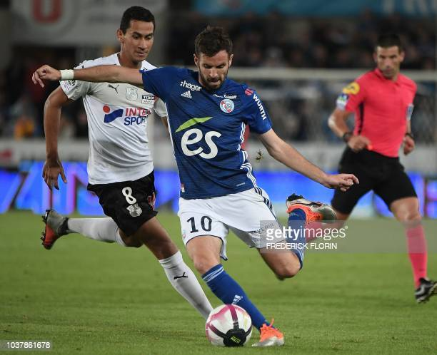 Strasbourg's French midfielder Benjamin Corgnet vies with Amiens' Brasilian forward Paulo Ganso during the French L1 football match between...