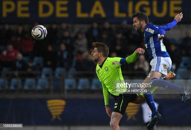 Strasbourg's French midfielder Benjamin Corgnet vies with Lille's midfielder Miguel Da Silva Rocha during the French League Cup football match...