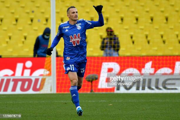 Strasbourg's French midfielder Dimitri Lienard celebrates after scoring a penalty kick during the French L1 football match between FC Nantes and RC...