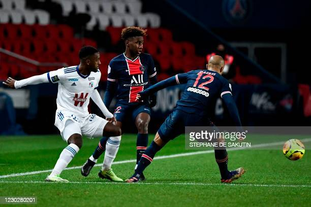 Strasbourg's French midfielder Ibrahima Sissoko fights for the ball with Paris Saint-Germain's French defender Timothee Pembele and Paris...