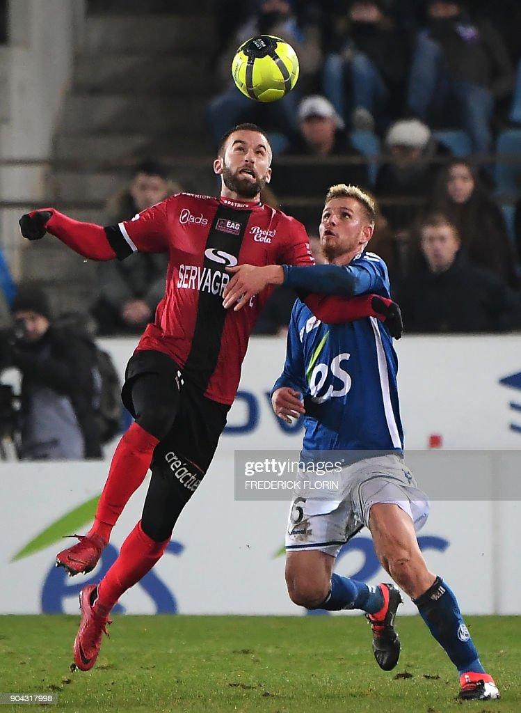 Strasbourg's French midfielder Jeremy Grimm (R) vies with Guincamp's French midfielder Lucas Deaux during the French L1 football match between Strasbourg (RCSA) and Guingamp (EAG) on January 12, 2018 at the Meinau stadium in Strasbourg, eastern France. /