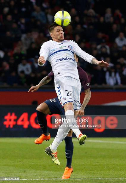 Strasbourg's French midfielder Jonas Martin heads the ball during the French Ligue 1 football match between Paris SaintGermain and Strasbourg at The...