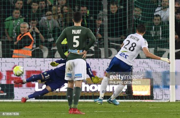 Strasbourg's French midfielder Jonas Martin scores a penalty past SaintEtienne's French goalkeeper Stephane Ruffier as SaintEtienne's French...