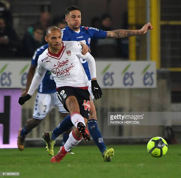 Strasbourg's French midfielder Jonas Martin vies with Bordeaux's Danish forward Martin Braithwaite during the French L1 football match between...