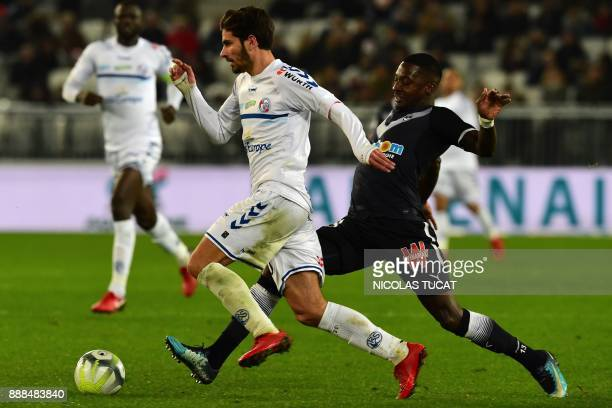 Strasbourg's French midfielder Martin Terrier fights for the ball with Bordeaux's Senegalese midfielder Younousse Sankhare during the French Ligue 1...