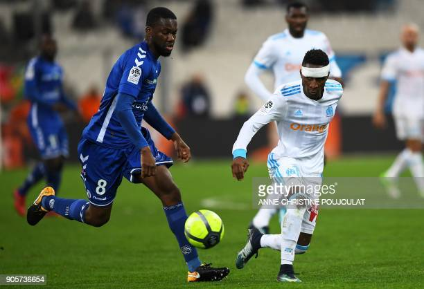 Strasbourg's Ivorian defender JeanEudes Aholou vies with Olympique de Marseille's French forward Bouna Sarr during the French L1 football match...