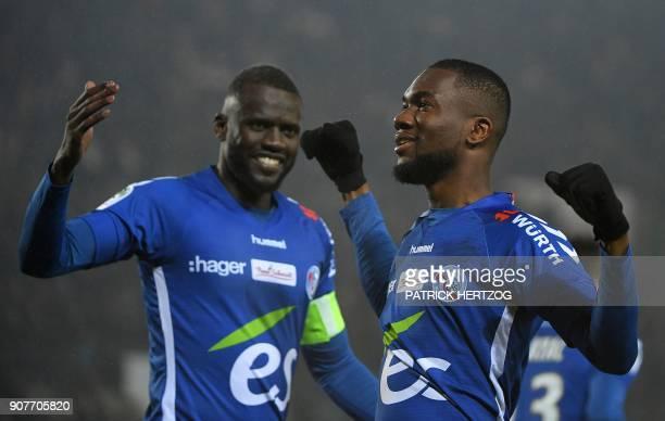 Strasbourg's Ivorian midfielder JeanEudes Aholou celebrates with Strasbourg's Senegalese defender Kader Mangane after scoring a goal during the...