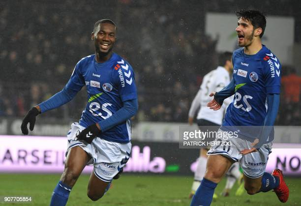 Strasbourg's Ivorian midfielder JeanEudes Aholou celebrates with Strasbourg's French forward Martin Terrier after scoring a goal during the French...