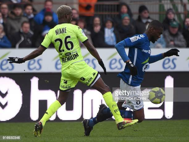 Strasbourg's Ivorian midfielder JeanEudes Aholou vies with Troyes' Malian forward Adama Niane during the French L1 football match between Strasbourg...