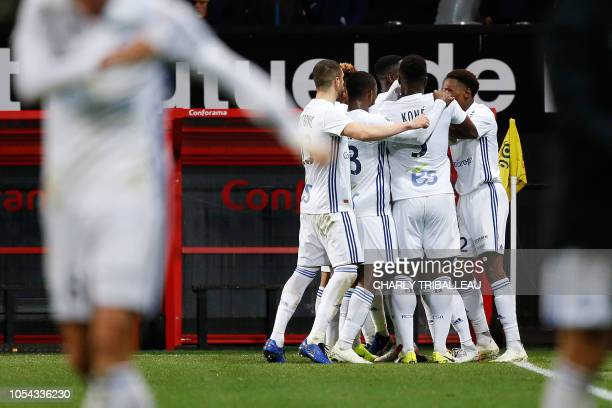 Strasbourg's Malian forward Lucien Zohi celebrates with teammates after scoring a goal during the French L1 football match between Guingamp and...