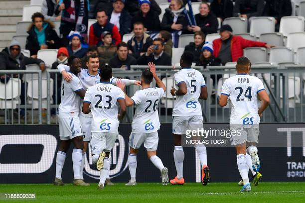 Strasbourg's players celebrate after scoring a goal during the French Ligue 1 football match between Bordeaux and Strasbourg on December 15 2019 at...
