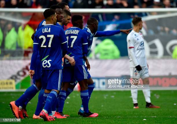 Strasbourg's players celebrate after scoring during the French L1 football match between Olympique Lyonnais and Racing Club Strasbourg Alsace at the...