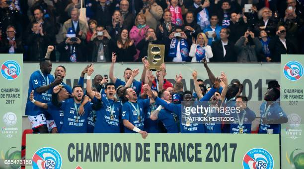 Strasbourg's players celebrate after winning the French L2 football match between Strasbourg and BourgenBresse and the Ligue 2 championship and pass...