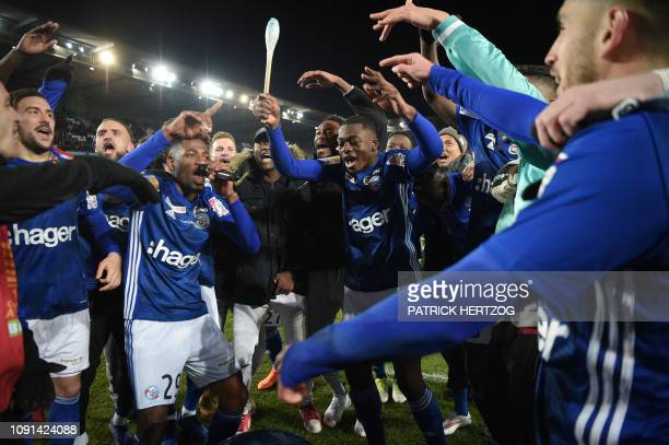 Strasbourg's players celebrate after winning the French League Cup semifinal football between Strasbourg and Bordeaux on January 30 at the Meinau...