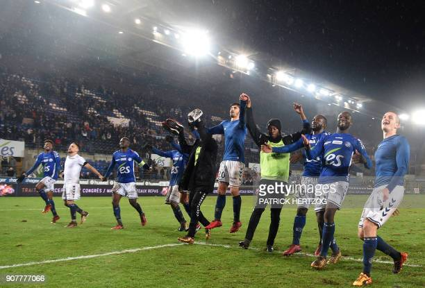 Strasbourg's players celebrate at the end of the French Ligue 1 football match between Strasbourg and Dijon on January 20 2018 at the Meinau stadium...