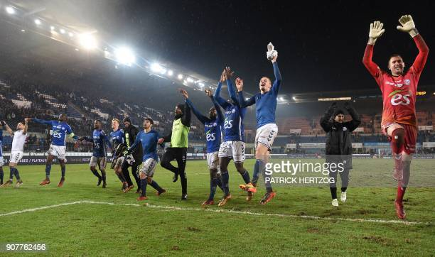 Strasbourg's players celebrate following the French Ligue 1 football match between Strasbourg and Dijon on January 20 2018 at the Meinau stadium in...