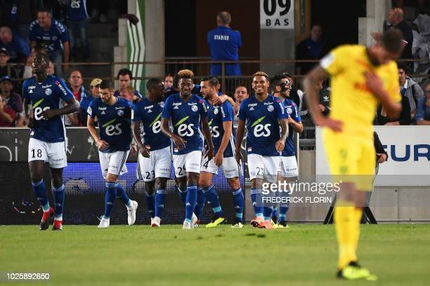 Strasbourg's players celebrate their first goal during the French L1 football match between Strasbourg and Nantes on September 1 at the Meinau...