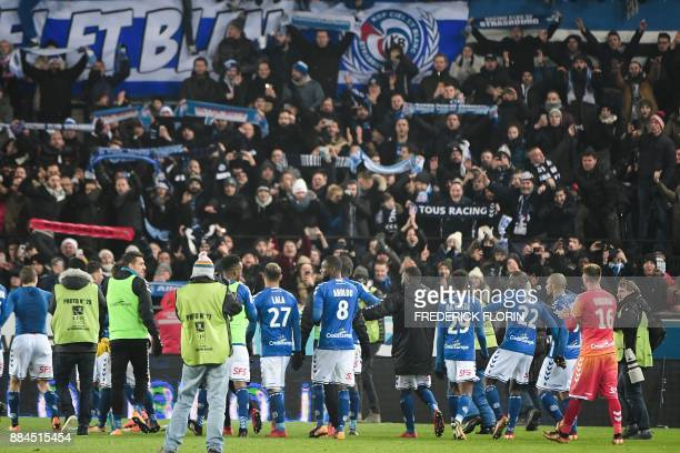 Strasbourg's players celebrate with their fans after winning the French L1 football match between Strasbourg and Paris SaintGermain at the Meinau...