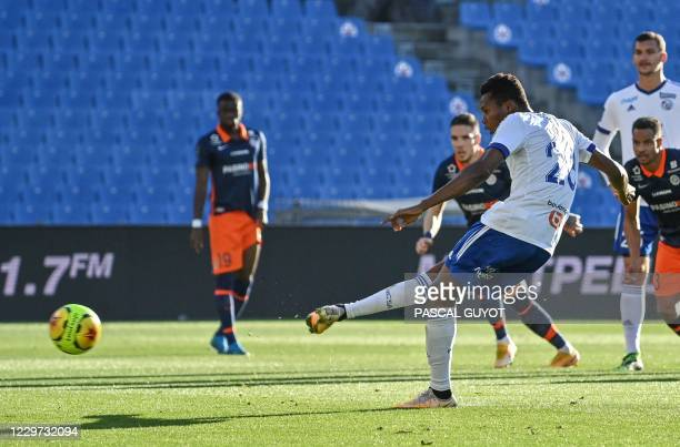 Strasbourg's Senegalese forward Habib Diallo shoots a penalty kick and scores a goal during the French L1 football match between Montpellier and...