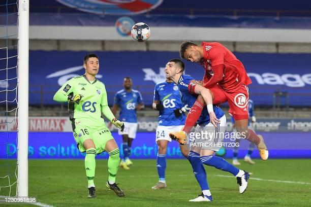Strasbourg's Serbian defender Stefan Mitrovic vies with Brest's Beninese forward Steve Mounie past Strasbourg's Japanese goalkeeper Eiji Kawashima...