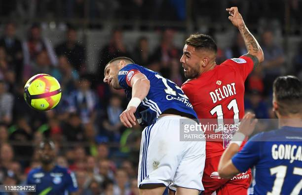 Strasbourg's Serbian defender Stefan Mitrovic vies with Montpellier's French forward Andy Delfort during the French L1 football match between...