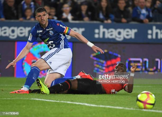 Strasbourg's Serbian defender Stefan Mitrovic vies with Rennes' Senegalese forward M'Baye Niang during the French L1 football match between...
