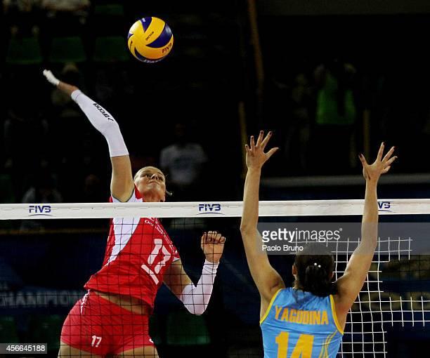 Strashimira Filipova of Bulgaria spikes the ball as Yana Yagodina of Kazakhstan blocks during the FIVB Women's World Championship pool F match...