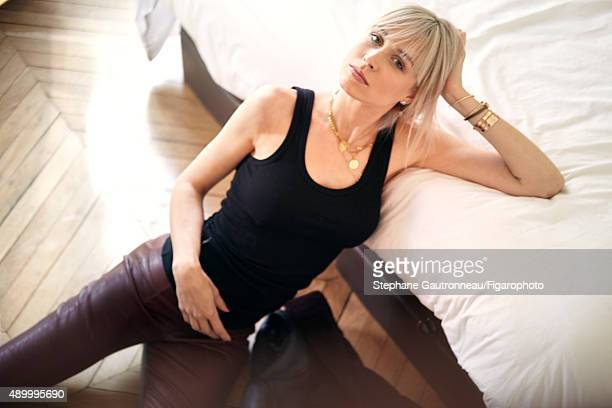 Strategy consultant AnneSophie Mignaux is photographed for Madame Figaro on May 21 2015 in Paris France Tank top leggings boots jewelry personal...