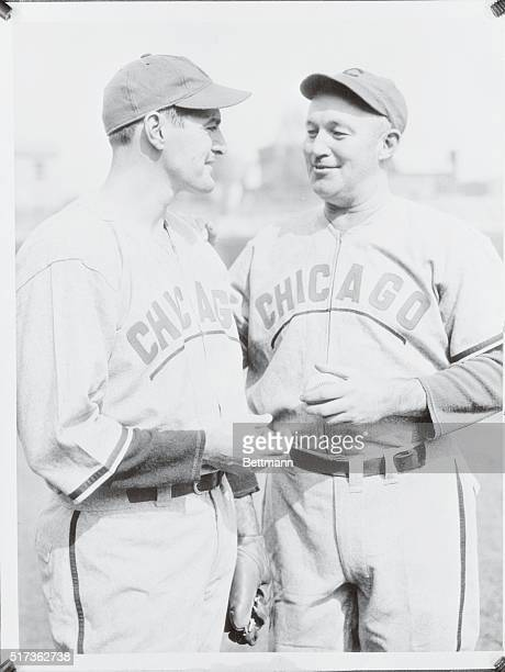 Strategy Gabby Hartnett right manager and catcher of the Chicago Cubs and Bill Lee who will be the starting pitcher for the Bruins in the opening...