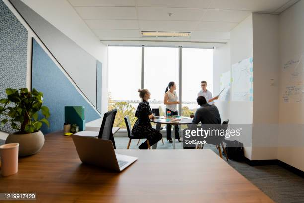 strategy team meeting - wide shot stock pictures, royalty-free photos & images