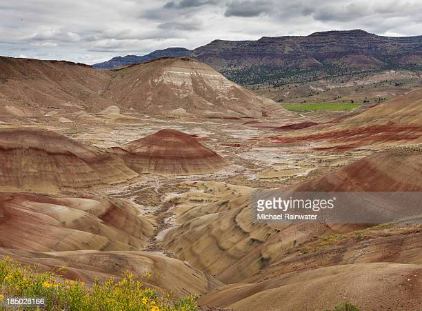 stratified hills in rust and brown - rust colored stock photos and pictures