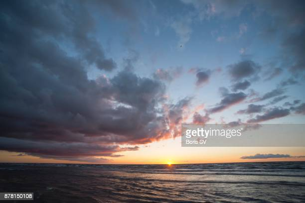 Stratocumulus Clouds over the sea during sunset
