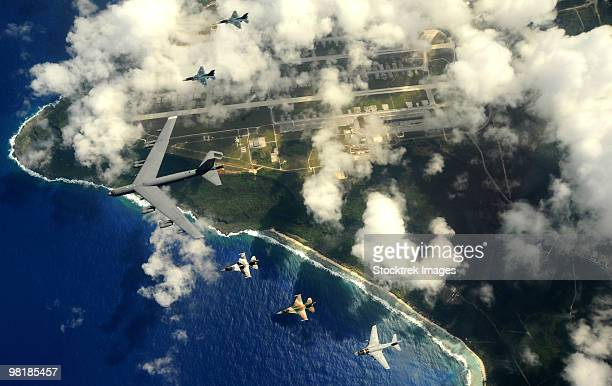 A B-52 Stratofortress leads a formation of aircraft over Guam.